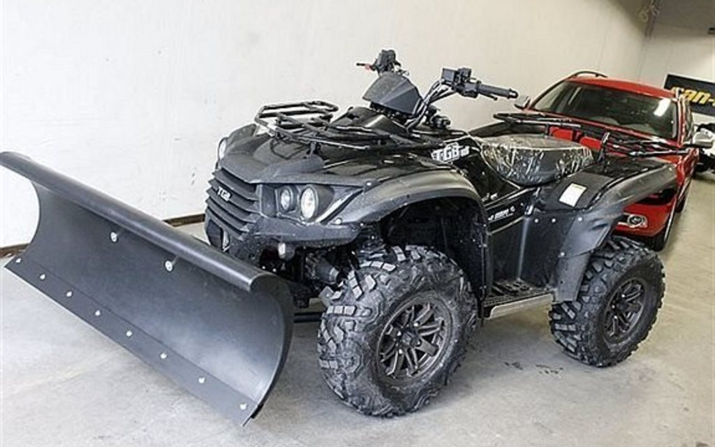 Fyrhjuling med plog
